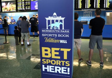 FILE PHOTO: Gamblers place bets on sports at Monmouth Park Sports Book by William Hill, shortly after the opening of the first day of legal betting on sports in Oceanport, New Jersey, U.S., June 14, 2018. REUTERS/Mike Segar/File Photo